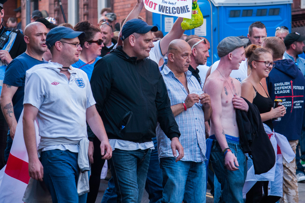 Centre, rolling cigarette: Conrad Ayscough, Halifax EDL